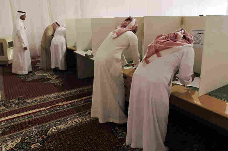 Voters cast ballots in municipal elections in Saudi Arabia. In 2011, King Abdullah of Saudi Arabia granted women the right to vote and run in municipal elections — but not until 2015.