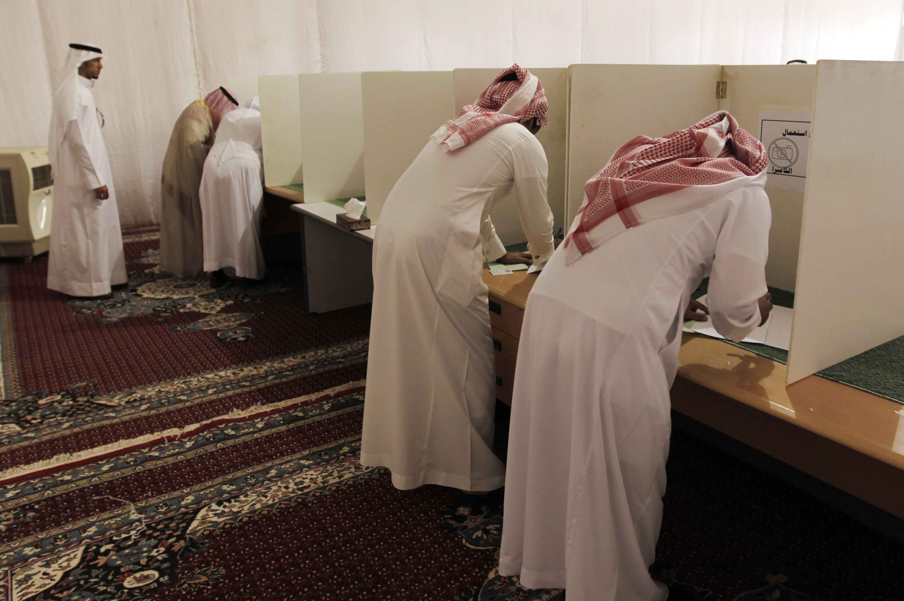 Voters cast ballots in municipal elections in Saudi Arabia. In 2011, King Abdullah of Saudi Arabia granted women the right to vote and run in municipal elections -- but not until 2015.