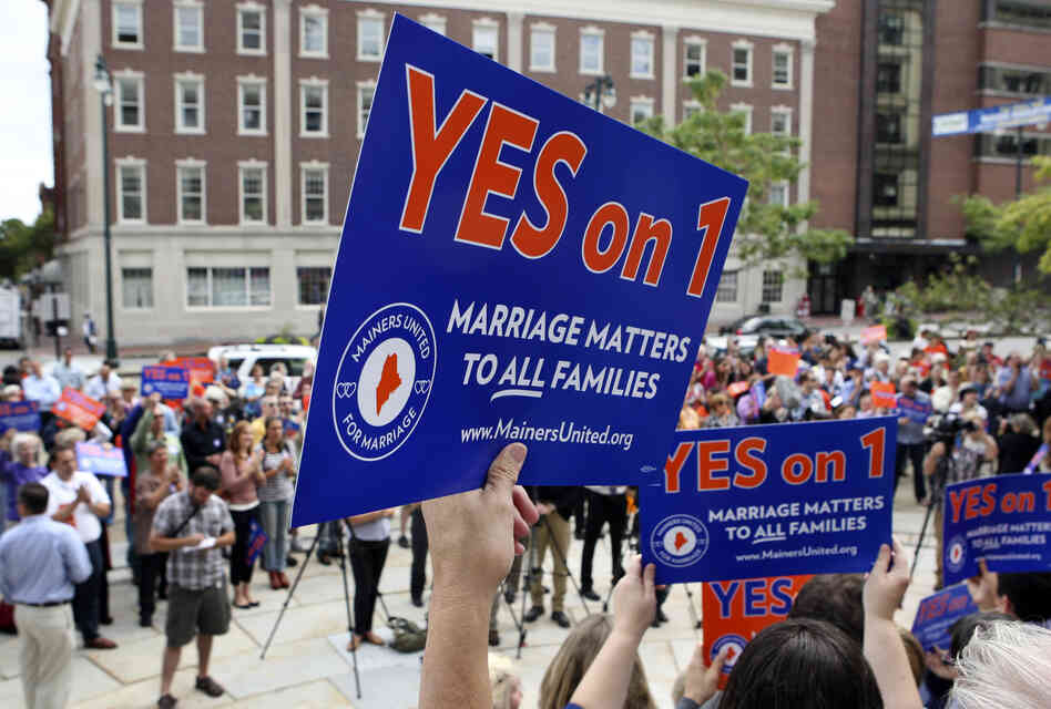 Maine voters overturned a gay marriage law through a citizens' veto in 2009. Maine voted again on the issue today, thanks to an initiative put on the ballot by voter petition. Above, gay marriage supporters gather at a rally outside of City Hall in Portland on Sept. 10.