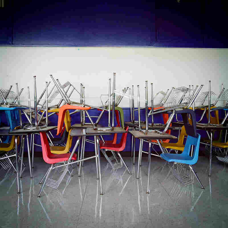 School desks are piled on top of each other at H.S. Thompson Elementary School in Dallas. Thompson was one of 11 schools closed by DISD in 2012.