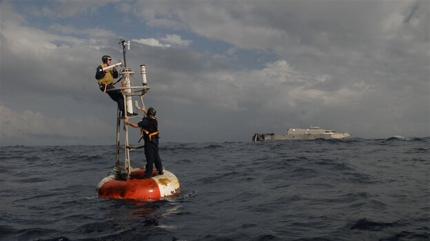 Navy specialists repair a weather buoy collecting data for the National Oceanic and Atmospheric Administration (NOAA) off the Atlantic coast of Africa. President Richard Nixon, a Republican, created NOAA, one of our principal resources for understanding the Earth's climate.