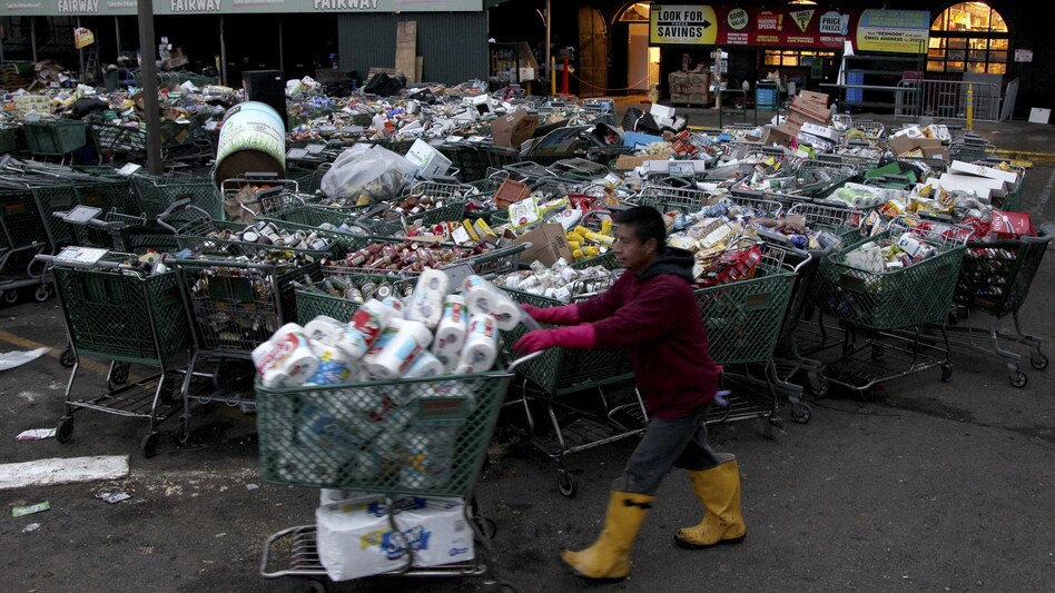 Shopping carts full of food damaged by Sandy await disposal at Fairway.
