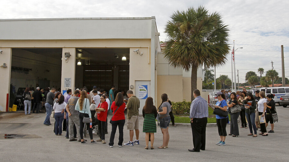 Voters stand in line as they prepare to cast their votes in Hialeah, Fla., on Tuesday. (AP)