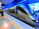 Passengers wait to board the Gautrain, Africa's first high-speed train, in Johannesburg, South Africa, Aug. 2, 2011. The train travels at speeds of up to 100 mph and makes commuting much easier for South Africans accustomed to congested roads and traffic jams.