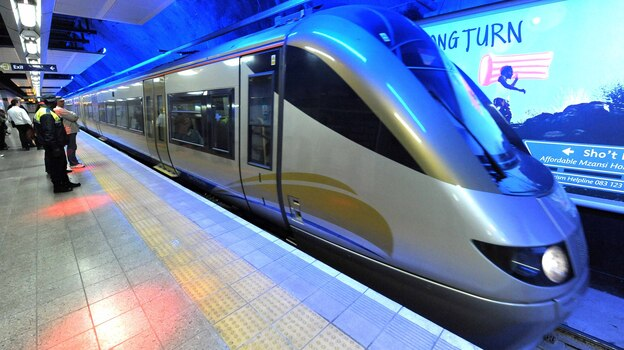 Passengers wait to board the Gautrain, Africa's first high-speed train, in Johannesburg, South Africa, Aug. 2, 2011. The train travels at speeds of up to 100 mph and makes commuting much easier for South Africans accustomed to congested roads and traffic jams. (Xinhua /Landov)