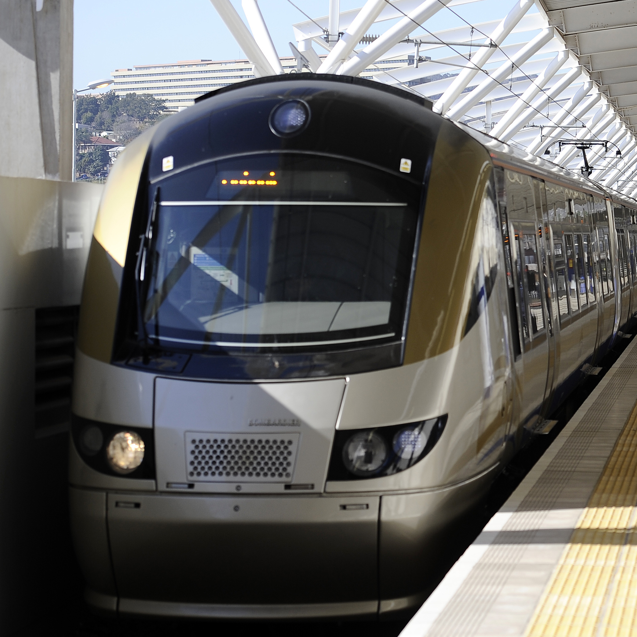 Passengers wait to get on the Gautrain, Africa's first high-speed rail line. The Gautrain began service in 2010, and the passengers shown here in August 2011 boarded on the first day the line was extended from Johannesburg to the capital Pretoria.