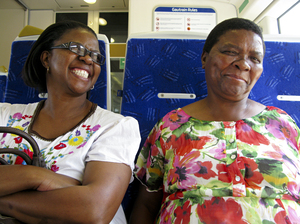 Refilwe Edith Seabi (left) and her sister Girlie are taking the Gautrain from Pretoria to go shopping in Johannesburg. Seabi is pleased when the ride clocks in at 30 minutes ? compared with a drive that sometimes takes her two hours.