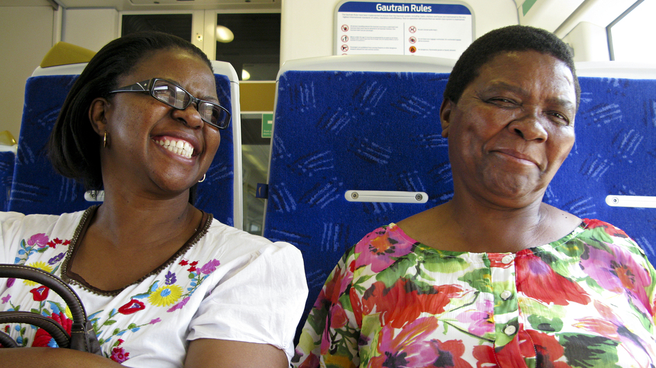 Refilwe Edith Seabi (left) and her sister Girlie are taking the Gautrain from Pretoria to go shopping in Johannesburg. Seabi is pleased when the ride clocks in at 30 minutes — compared with a drive that sometimes takes her two hours. (NPR)