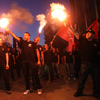 Members of the Greek ultranationalist Golden Dawn Party, sing the national anthem outside the party's office in Thessaloniki in June. The party's support has been boosted by anti-immigrant anger.