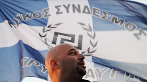 Ilias Panagiotaros, deputy of the Greek Parliament and member of Golden Dawn, looks on before giving a speech in Athens in June.