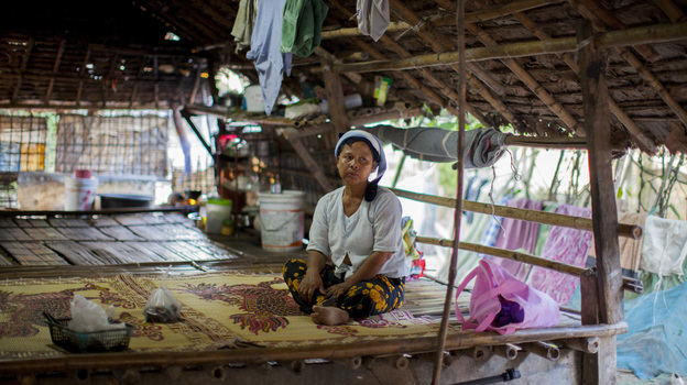 Daw Khin Twon, an undocumented immigrant from Burma, rests at home after receiving malaria treatment at the Mae Tao Clinic in Mae Sot, Thailand. (NPR)