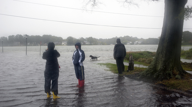 Residents of the Colonial Place neighborhood watch as heavy rain from Hurricane Sandy floods the Lafayette River in Norfolk, Va., on Oct. 28. (Reuters/Landov)