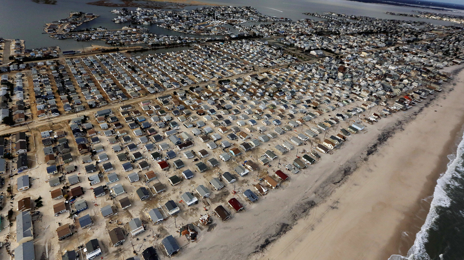 Homes are surrounded by sand washed in by Superstorm Sandy on Oct. 31 in Seaside Heights, N.J. (Getty Images)