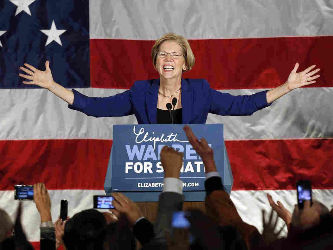 Democrat Elizabeth Warren takes the stage after defeating incumbent GOP Sen. Scott Brown in the Massachusetts Senate race on Tuesday.