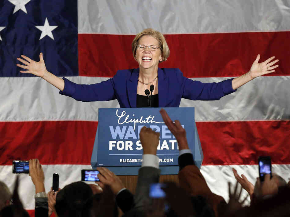 Democrat Elizabeth Warren takes the stage after defeating incumbent GOP Sen. Scott Brown in the Massachusetts Senate race on Tuesday.