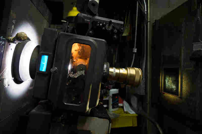 Projector in the booth at Jackson Heights Cinema in Queens, N.Y., a former Bollywood theater that now shows many films subtitled in Spanish.