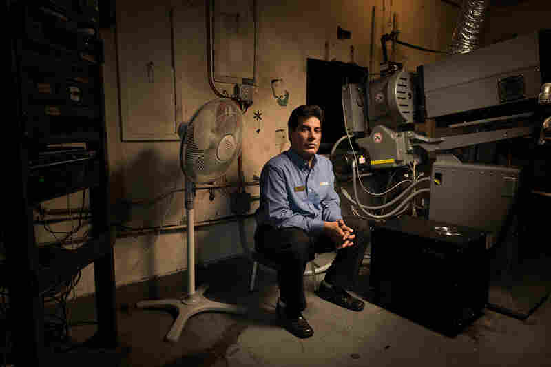 Projectionist Nadeem Malik at the Bombay Theater, Flushing, N.Y.