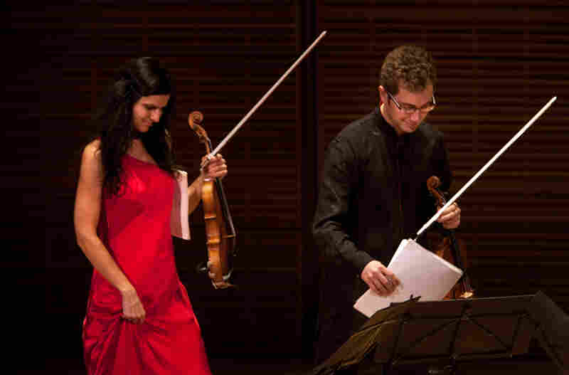 The Belcea Quartet's violinists Corina Belcea and Axel Schacher, walk onstage just before playing Beethoven's String Quartet in E flat, Op. 127.