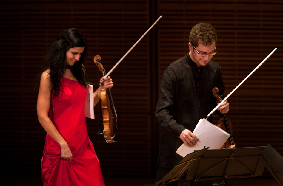 The Belcea Quartet's violinists Corina Belcea and Axel Schacher, walk onstage just before playing Beethoven's String Quartet in E flat, Op. 127.  (NPR)