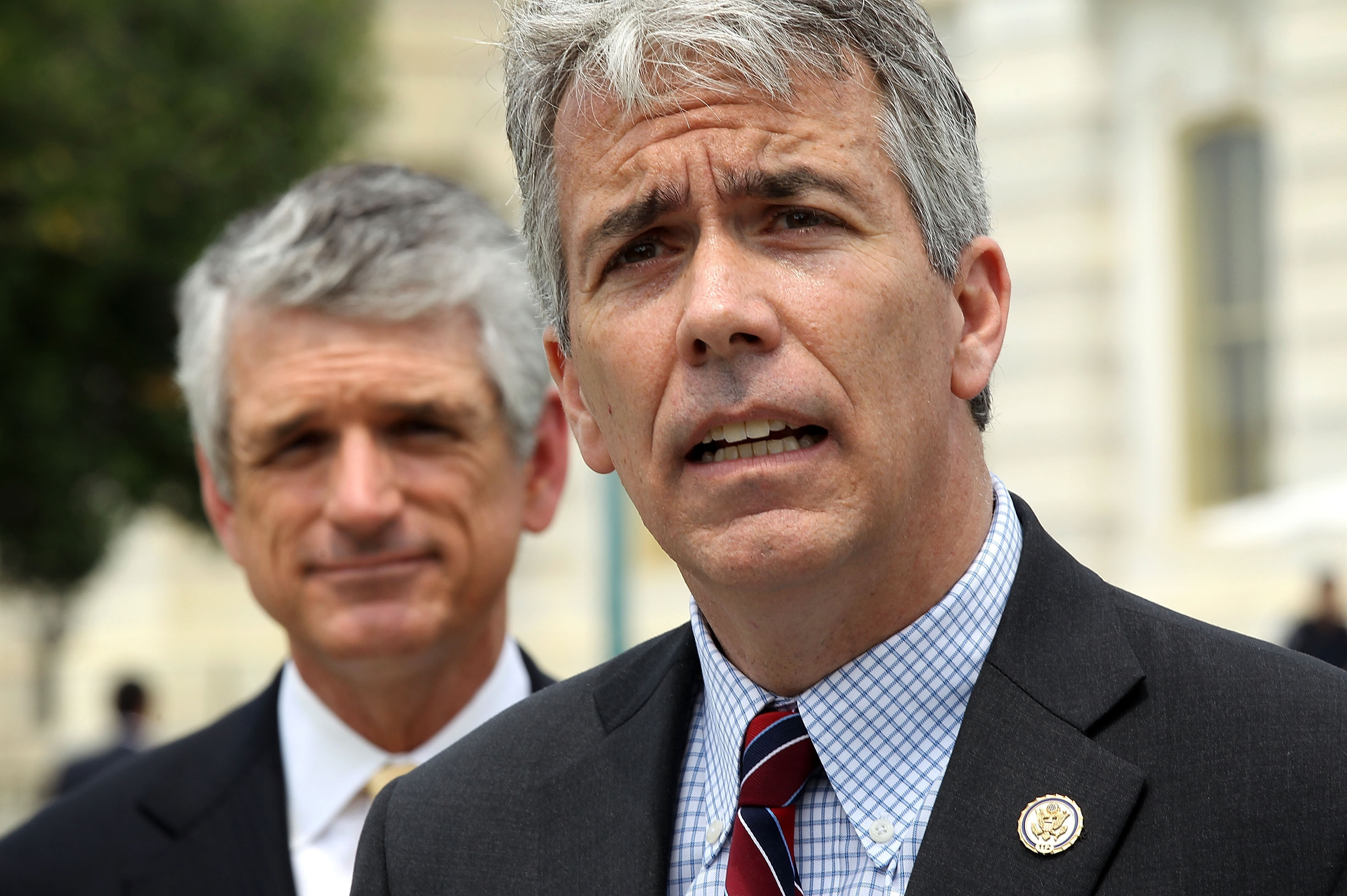 OUT: Illinois Republican Rep. Joe Walsh (foreground), with Virginia Rep. Scott Rigell, speaks during a May news conference on Capitol Hill. Walsh, a Tea Party freshman, lost to Democrat Tammy Duckworth.