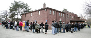 African-American turnout and enthusiasm for Obama are matching levels seen four years ago. Above, voters wait in a long line in Detroit, Mich., on Tuesday.