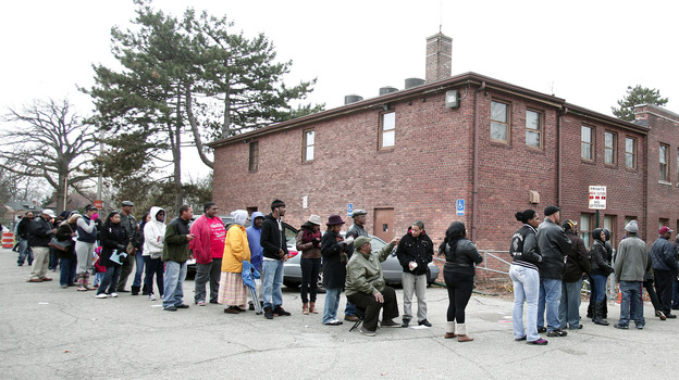 African-American turnout and enthusiasm for Obama are matching levels seen four years ago. Above, voters wait in a long line in Detroit, Mich., on Tuesday. (Getty Images)