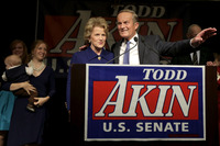 OUT: Missouri Republican Rep. Todd Akin and his wife, Lulli, acknowledge supporters before Akin makes his concession speech to incumbent Democratic Sen. Claire McCaskill on Tuesday in Chesterfield, Mo.