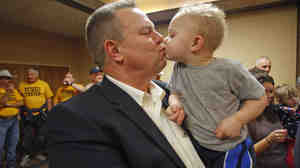 Sen. Jon Tester, D-Mont., receives a kiss from his grandson Wednesday in Great Falls, Mont. Tester won re-election in a tight contest with Republican Rep. Denny Rehberg.
