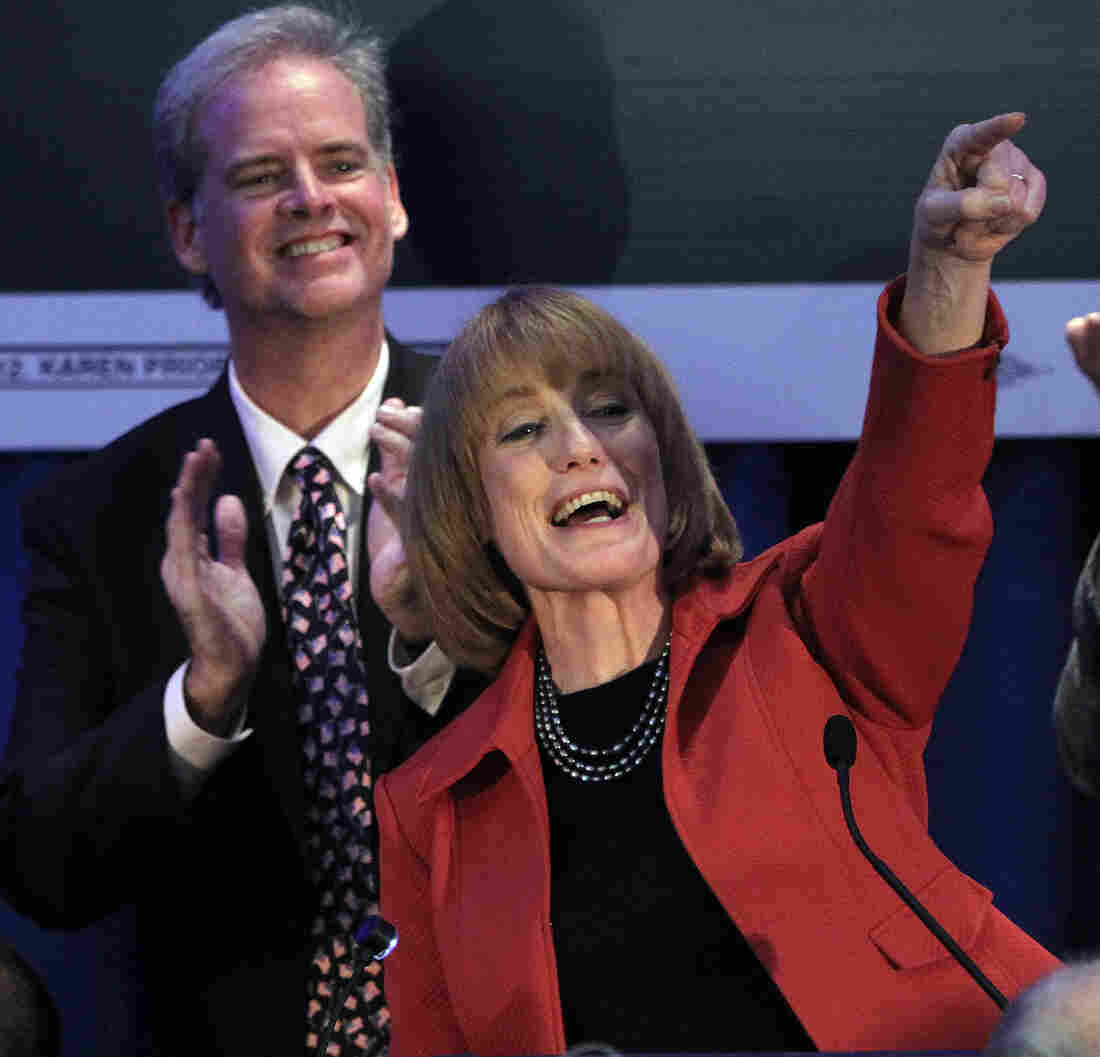 Governor-elect Maggie Hassan thanks supporters with her husband Tom on Tuesday in Manchester, N.H. Hassan beat Ovide Lamontagne to keep the governor's seat in Democratic control.
