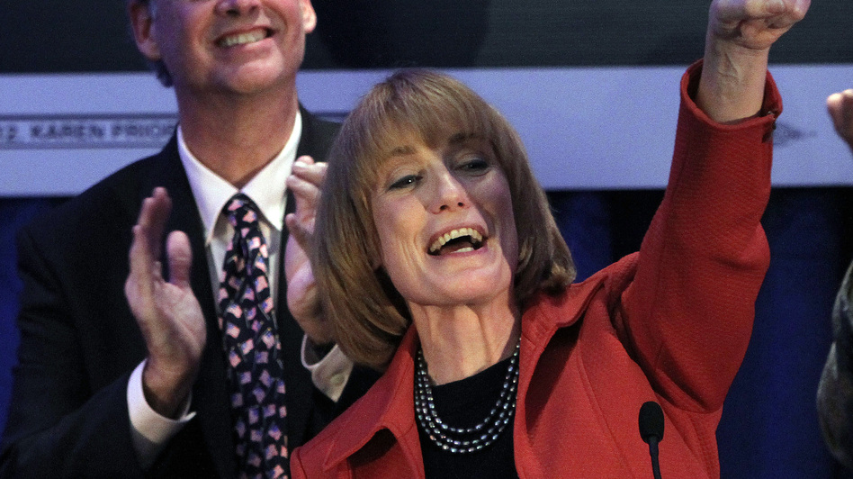 Governor-elect Maggie Hassan thanks supporters with her husband Tom on Tuesday in Manchester, N.H. Hassan beat Ovide Lamontagne to keep the governor's seat in Democratic control. (AP)