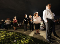 Voters line up in the dark Tuesday to cast their ballots at a polling station in Miami. President Obama said the long lines nationwide were something