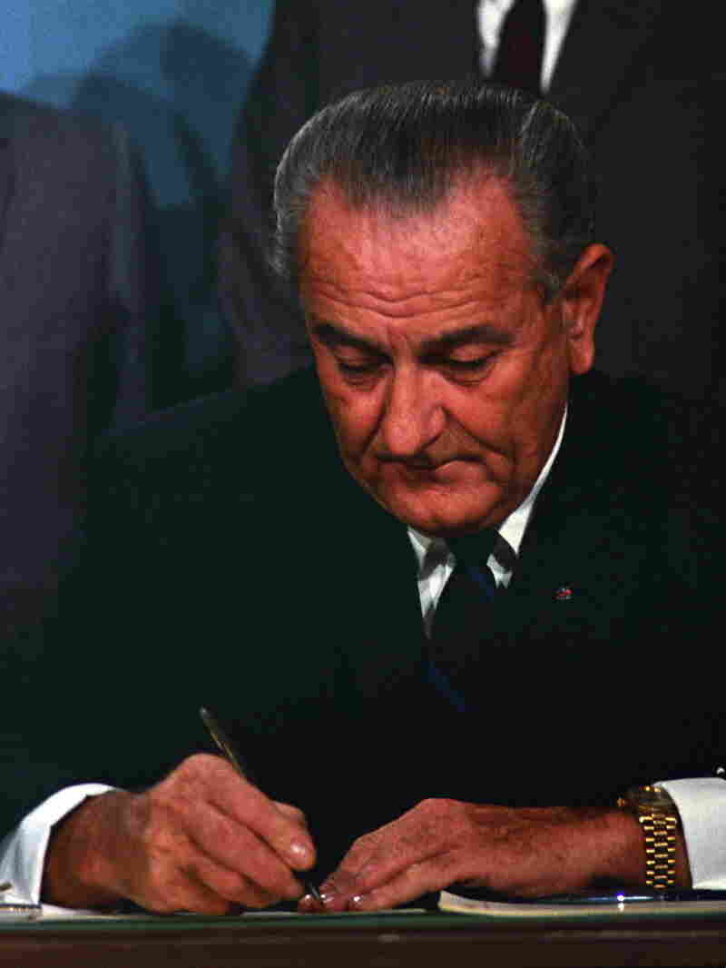 President Lyndon B. Johnson signs the Public Broadcasting Act of 1967