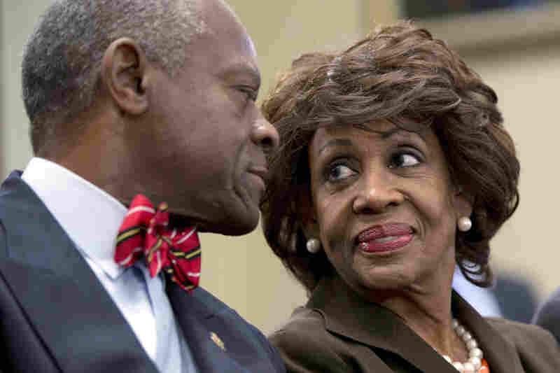 IN: California Democratic Rep. Maxine Waters smiles at her husband, Sidney Williams, during a House Ethics Committee hearing in September. Waters was cleared of charges that she steered a $12 million federal bailout to a bank where her husband owns stock.