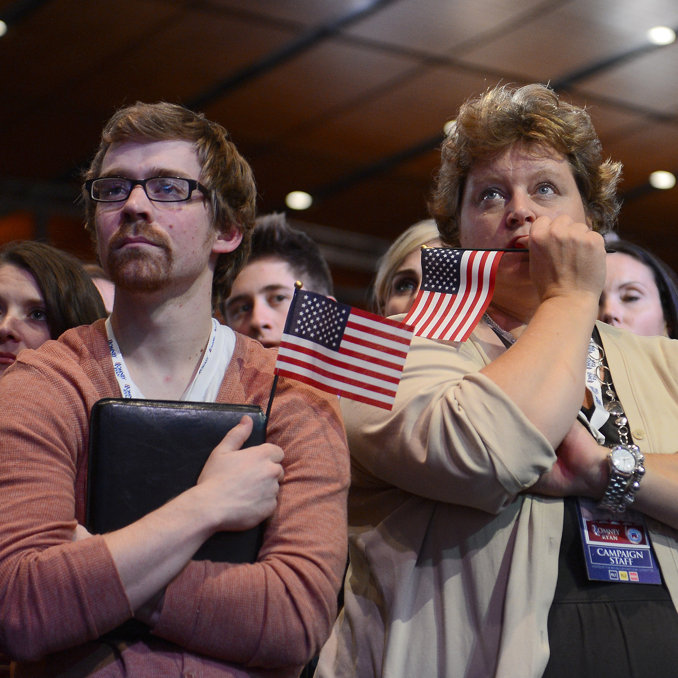 Supporters of Republican presidential candidate Mitt Romney react to his defeat in Boston.