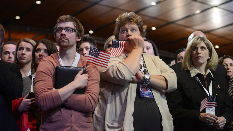 Supporters of Republican presidential candidate Mitt Romney react to his defeat in Boston. (AFP/Getty Images)