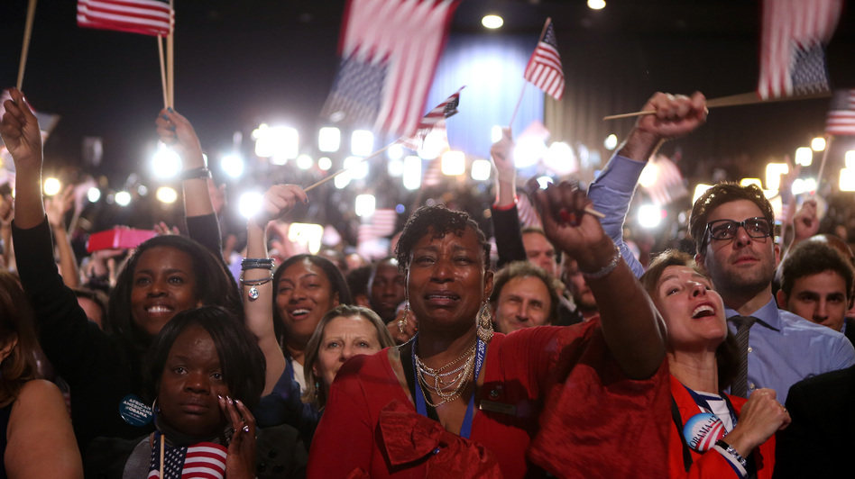 Supporters cheer as President Obama delivers his victory speech in Chicago. (Getty Images)