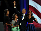 President Obama walks on stage with first lady Michelle Obama and daughters Sasha and Malia to deliver his victory speech on election night in Chicago.