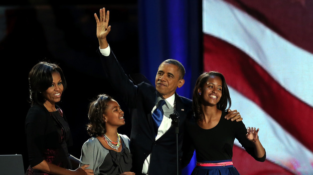 President Obama walks on stage with first lady Michelle Obama and daughters Sasha and Malia to deliver his victory speech on election night in Chicago. (Getty Images)
