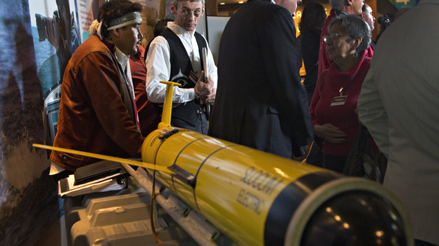 John Disney (second from left) looks over the underwater probe used in his company's ocean fertilization project, at a news conference in Vancouver, British Columbia, in October. (Reuters/Landov)