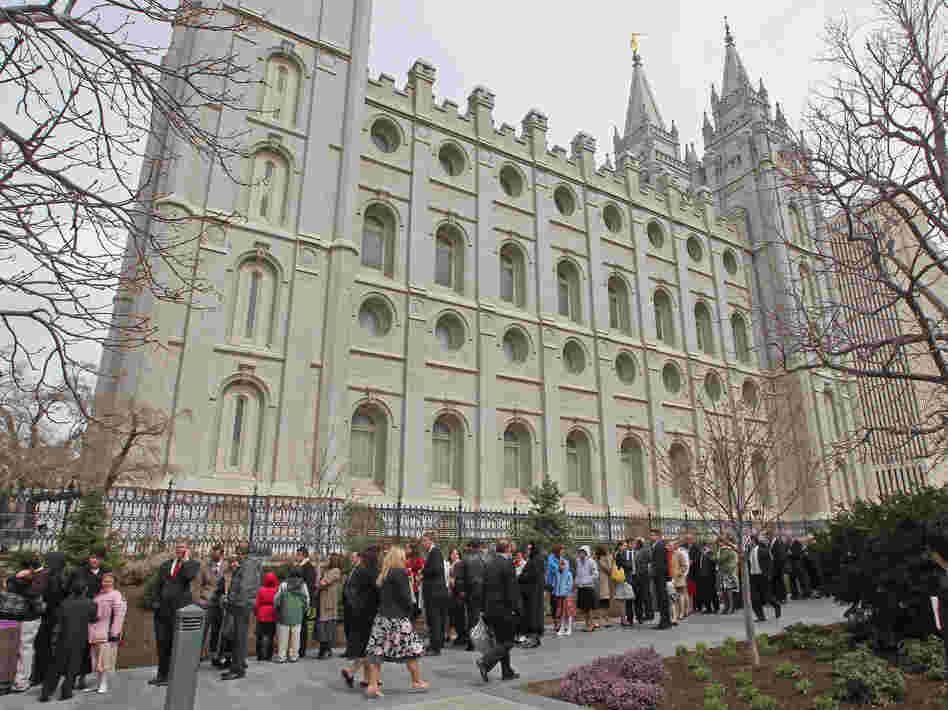 Mormons line up outside the historic Salt Lake Temple for an annual conference in April 2010.
