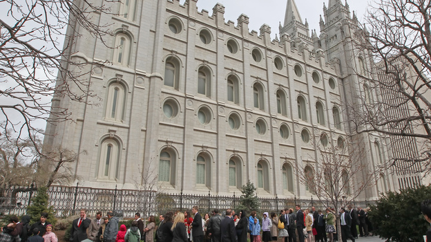 Mormons line up outside the historic Salt Lake Temple for an annual conference in April 2010. (Getty Images)