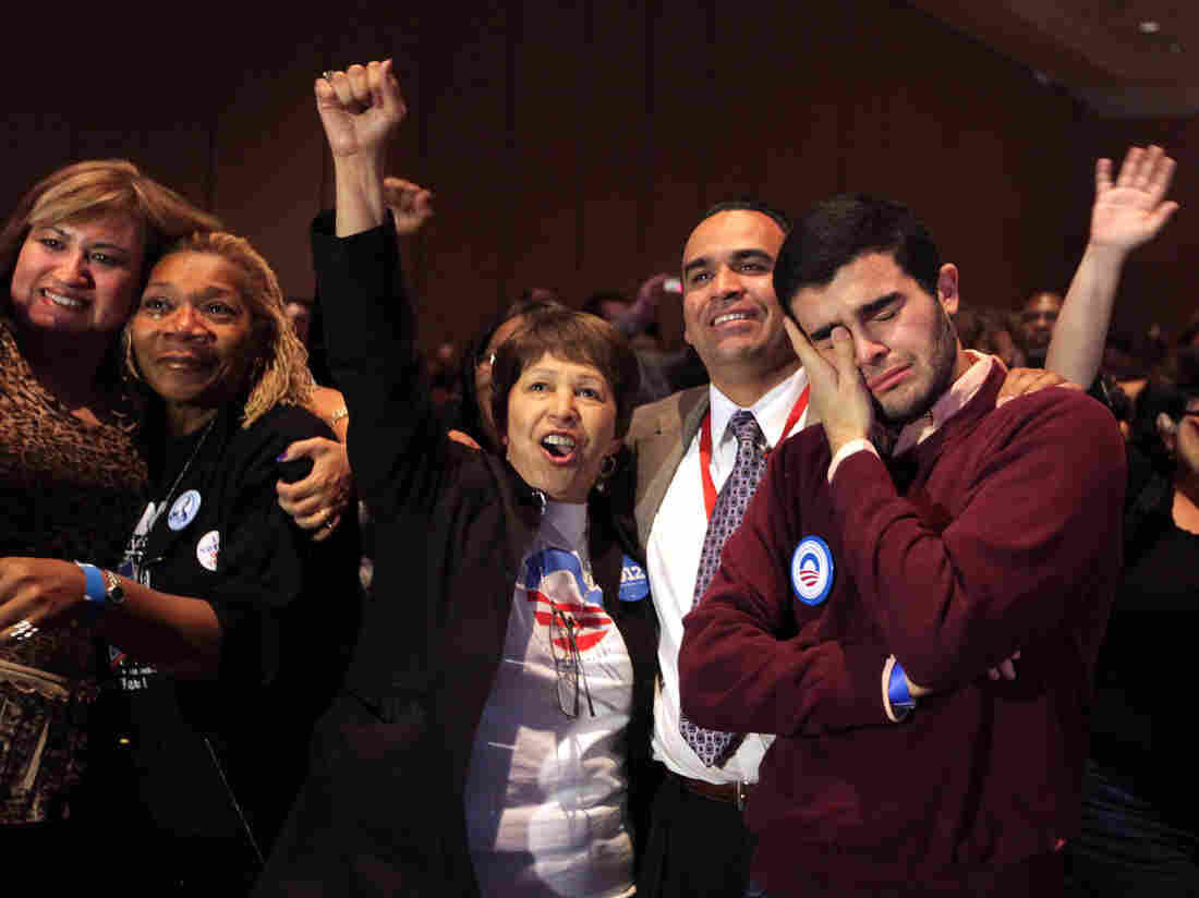 Obama supporters react as President Barack Obama was declared the winner Tuesday, during the Nevada State Democratic Party gathering at the Mandalay Bay Resort and Casino in Las Vegas.