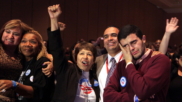 Obama supporters react as President Barack Obama was declared the winner Tuesday, during the Nevada State Democratic Party gathering at the Mandalay Bay Resort and Casino in Las Vegas. (AP)