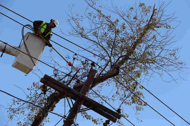 Crews work to restore power in Bethpage, N.Y., on Saturday. As of Wednesday, more than 200,000 Long Island residents were still without power, as a nor'easter made new outages likely.