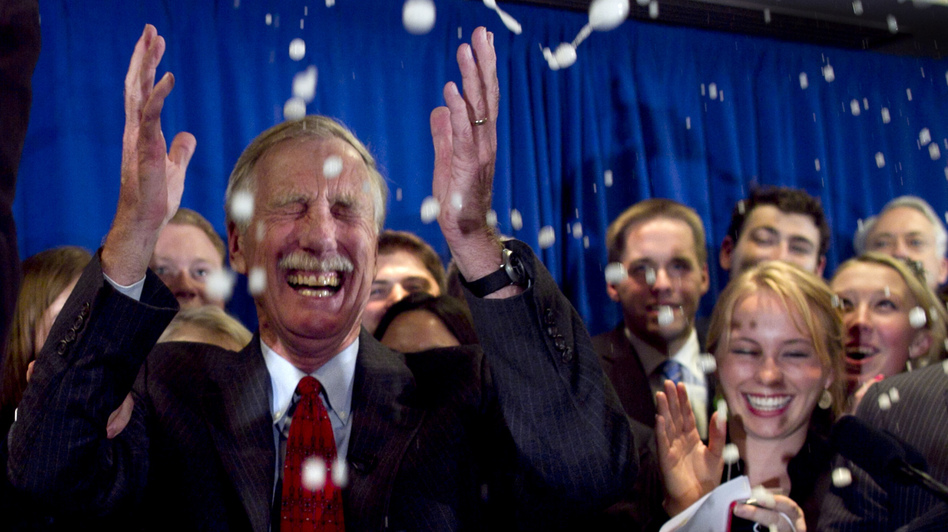 Independent Angus King celebrates under a splash of champagne in Freeport, Maine, on Tuesday, after winning the Senate seat vacated by Republican Olympia Snowe. (AP)