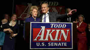Missouri Republican Senate candidate Todd Akin and his wife, Lulli, acknowledge supporters before Akin makes his concession speech to Democratic Sen. Claire McCaskill on Tuesday in Chesterfield, Mo.