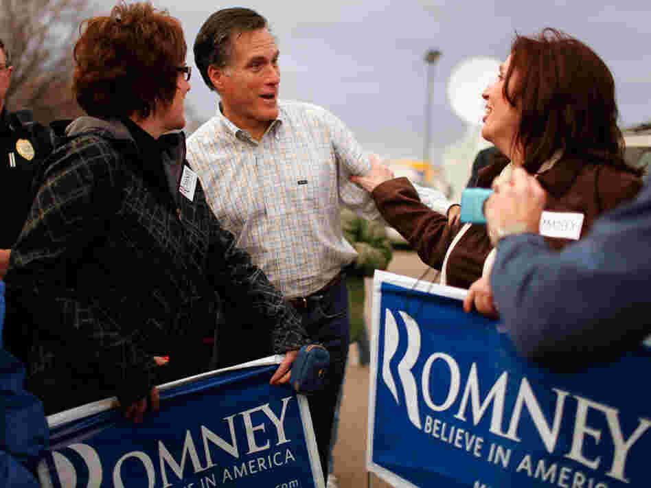 Republican presidential candidate Mitt Romney talks with supporters during a campaign event at the Family Table Restaurant in Le Mars, Iowa, in 2011.