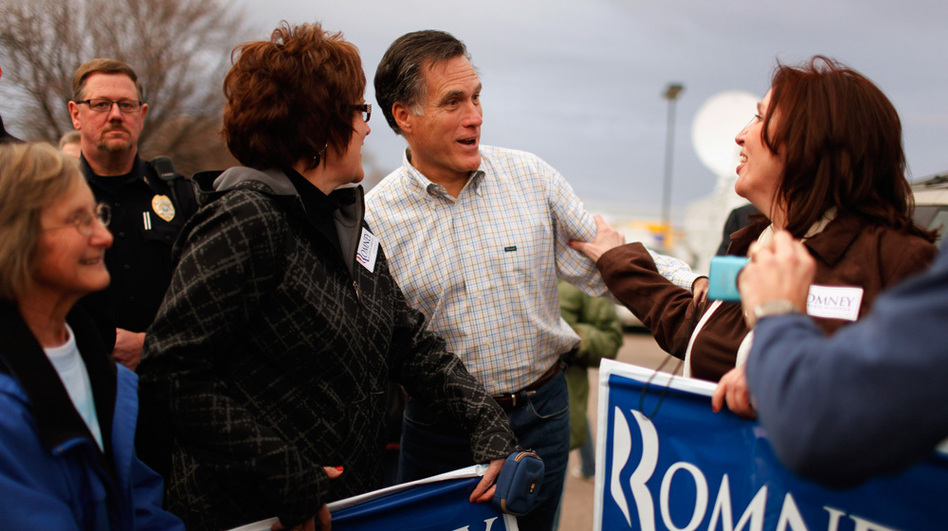 Republican presidential candidate Mitt Romney talks with supporters during a campaign event at the Family Table Restaurant in Le Mars, Iowa, in 2011. (Getty Images)
