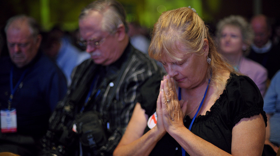 Attendees pray during The Family Research Council's Values Voter Summit on Sept. 14 in Washington, D.C. (AFP/Getty Images)