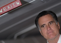 Mitt Romney talks to reporters on his campaign plane on Election Day.